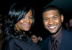 Usher and his fiancée, Tameka Foster