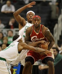 Boston's Paul Pierce and Rajon Rondo, left, pressure Cleveland's LeBron James in the first half.